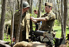 Bob Raines--Montgomery Media<br />  U.S. Army re-enactor Nick Dauka, right, checks Rob Giunta's sewing as he repairs his shirt in his machine gun position at the World War II Weekend at Graeme Park Saturday, May 2, 2015.