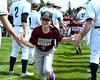 Diamond Backs Nikki Rindone was followed by Mason Keesler as they ran onto the field. Photo by Debby High