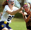 Bob Raines--Montgomery Media<br /> Upper Moreland's Veronica Baez and Wissahickon's Amanda Mitchell battle for the ball April 28, 2015.