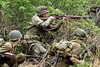 Bob Raines--Montgomery Media<br /> U.S. Army re-enactors out flank the German position during a skirmish at the World War II Weekend at Graeme Park Saturday, May 2, 2015.