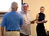 Bob Raines--Montgomery Media<br /> Phil Wimpenny, center, site coordinator, and Kristin Brisbon, United Way community impact specialist, honor Tom Sosna, one of the VITA volunteers recognized for for their tax preparation services May 4, 2015.