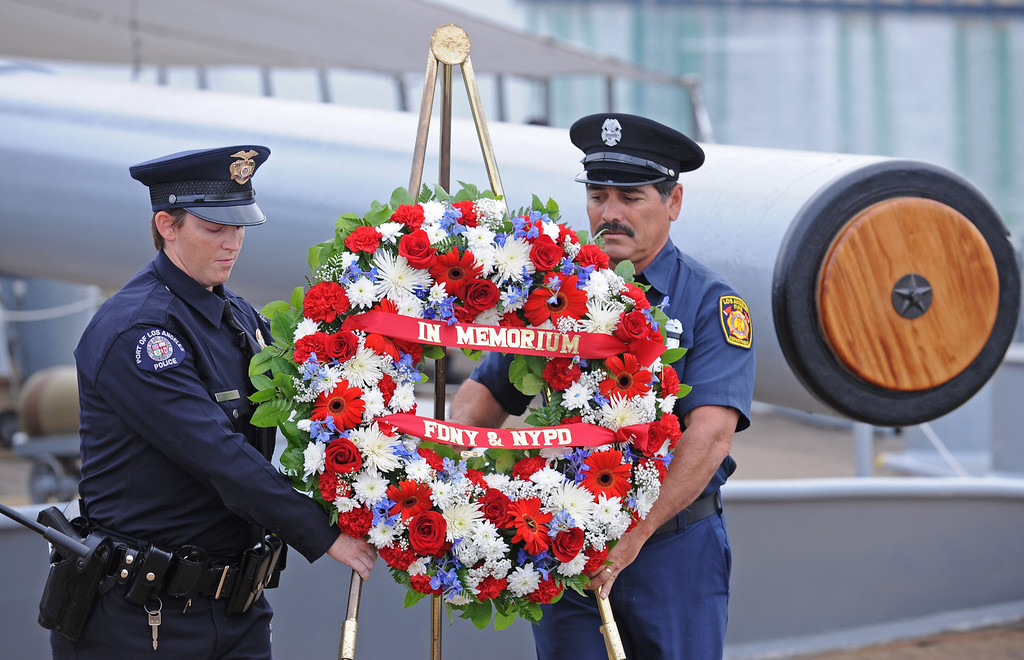 . L.A. Port Police Officer Stacey Creech and L.A.F.D. firefighter Rey LaValle present the memorial wreath. Observance event to honor 9/11 first responders aboard the USS Iowa in San Pedro. (Wed. Sept 11, 2013 Photo by Brad Graverson/The Daily Breeze