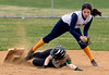 Bob Raines--Montgomery Media<br /> Christopher Dock runner Emily Gordon dislodges second base as she slides under Lower Moreland shortstop Jessica Poon.