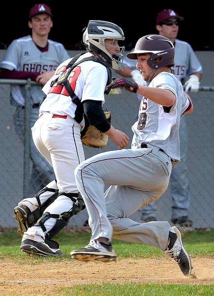 Bob Raines--Montgomery Media<br /> Abington's Brendan Gallagher scores as the throw to Tennent's AJ Shapiro goes wide April 15, 2015.