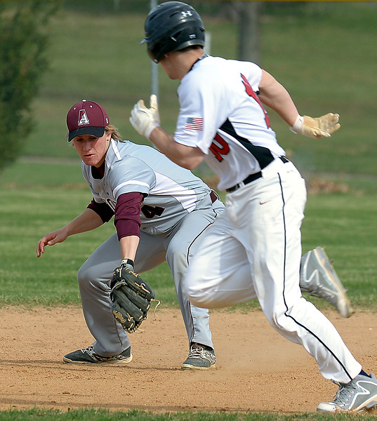 Bob Raines--Montgomery Media<br /> Abington second baseman Nick Torba stops a Tennent grounder and throws to first, ignoring Tennent runner Paul McElroy.