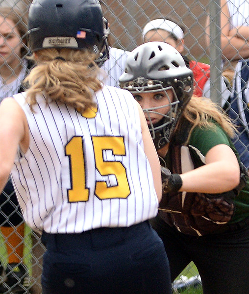 Bob Raines--Montgomery Media<br /> Christopher Dock catcher Emily Gordon makes the tag on Lower Moreland runner Samantha Casey at the plate April 14, 2015.