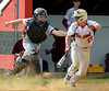 Bob Raines--Montgomery Media<br /> Abington catcher Nick Bein tags Tennent's Bobby Day as he tries to run on a third strike April 15, 2015.