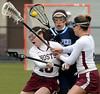 Bob Raines--Montgomery Media<br /> Casey McAllister's check misses North Penn's Maddy McClure but connects with Abington teammate Lindsay Baer  March 27, 2015.