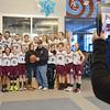 The Ayer-Shirley Middle School basketball team poses for photos with Nashoba Valley Medical Center nurse Kerry Krasinskas and Shirley firefighter/EMT Al Dreshler. Krasinskas will be donating her kidney to Dreshler, who has been battling kidney disease since 1999. SENTINEL & ENTERPRISE / Ashley Green