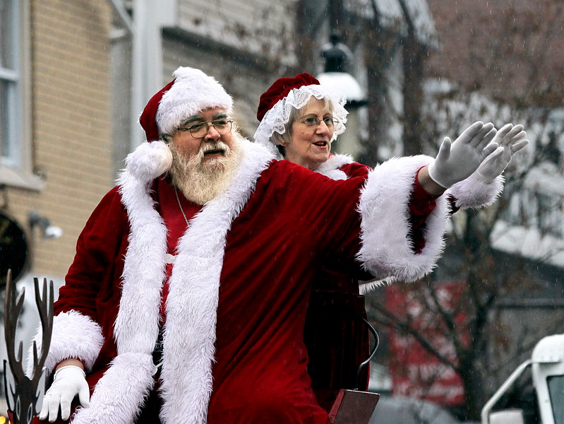 Santa and Mrs. Claus wave to the crowd who braved the drizzle to view the Ambler Holiday Parade Saturday, Dec. 6, 2014.<br /> Bob Raines-Montgomery Media