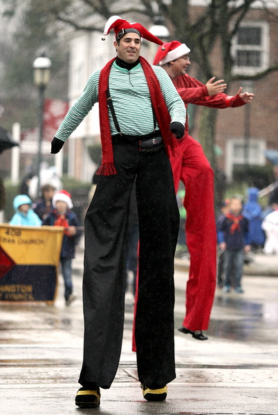 Stilt walkers make their way along Butler Ave. during the Ambler Holiday Parade Saturday, Dec. 6, 2014.<br /> Bob Raines-Montgomery Media