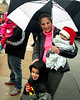 Christine Caruso watches the Ambler Holiday Parade with two of her children,Trevor, 7, and Tyler, 9 months, along Butler Ave. Saturday, Dec. 6, 2014.<br /> Bob Raines-Montgomery Media