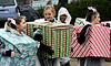 Girls from American Gymnastics march dressed as Christmas packages in the annual Ambler Holiday Parade Saturday, Dec. 6, 2014.<br /> Bob Raines-Montgomery Media