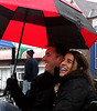 Steve and Heather D'Angelo have fun watching the Ambler Holiday Parade under an umbrella Saturday, Dec. 6, 2014.<br /> Bob Raines-Montgomery Media