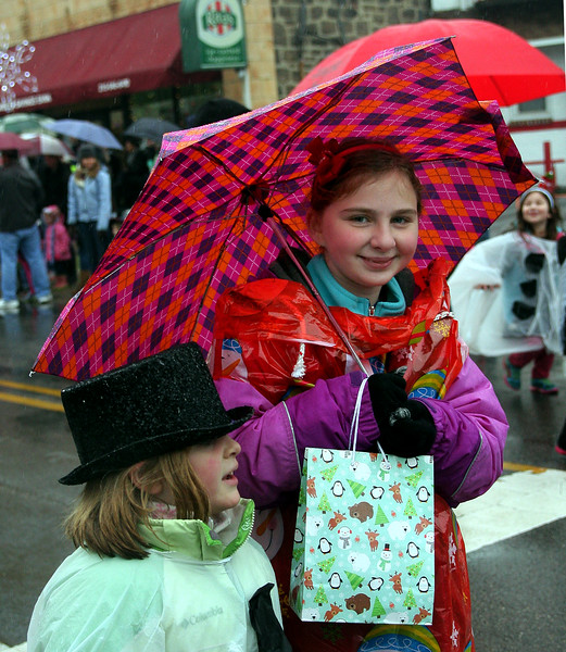 June Bartley, left, and Abby Shewring march with Brownie Troop 1242 in the Ambler Holiday Parade Saturday, Dec. 6, 2014.<br /> Bob Raines-Montgomery Media