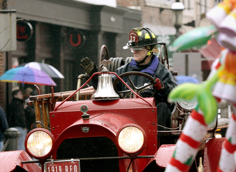 The Centre Square Fire Co. 1919 Reo firetruck chugs along Butler Ave. in the Ambler Holiday Parade Saturday, Dec. 6, 2014.<br /> Bob Raines-Montgomery Media