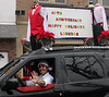 Frank Laguda announces the 40th anniversary in Ambler of Tony Laguda Formalwear During the Ambler Holiday Parade Saturday, Dec. 6, 2014.<br /> Bob Raines-Montgomery Media