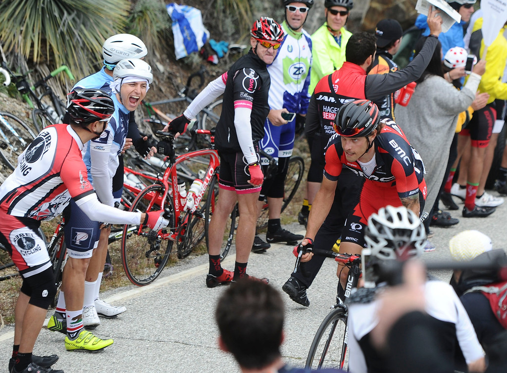 . Spectators cheer on a rider as he makes his way up the first KOM during the 80 mile Stage 7 of the Amgen Tour of California on Saturday, May 16, 2015. (Staff Photo by Sarah Alvarado/ Inland Valley Daily Bulletin)