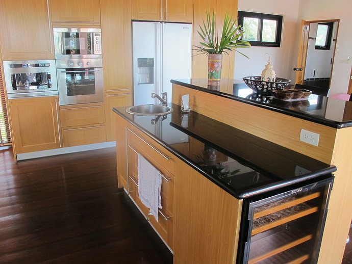 Fully Fitted Kitchen enjoys a hidden wine cooler