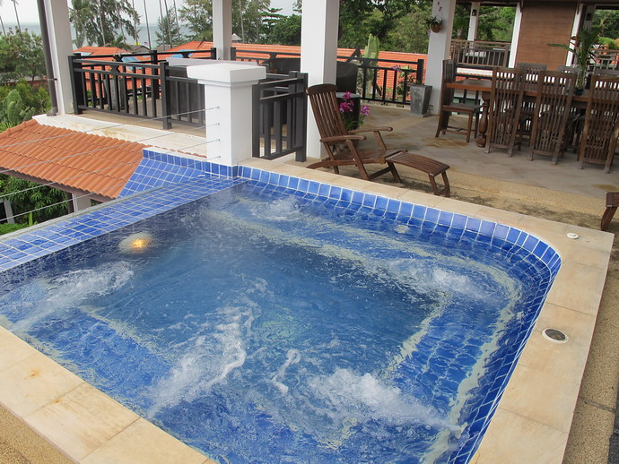 Outdoor Jacuzzi with an overflow creating a waterfall down the villa