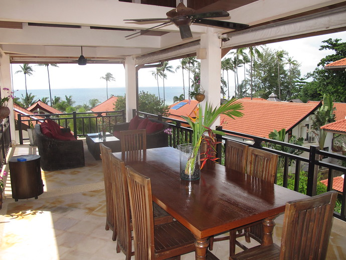 Outside upper level terrace dining area with sea views