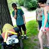 Andrew Siess talks Hilary Caldis, a friend from high school, right, and her boyfriend Haseeb Malik, back, about what he is carrying in his cart while meeting up with friends and family as he takes a break from walking around the world near Lake Calhoun in Minneapolis on Sunday, July 20, 2014.  (Pioneer Press: Sherri LaRose-Chiglo)