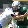 Billerica vs Stoneham high school football scrimmage. Stoneham's #11 tackles Billerica's #34. [No rosters] (SUN/Julia Malakie)