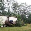 Tree down on house on Hilltop Road in Billerica.  (SUN/Julia Malakie)