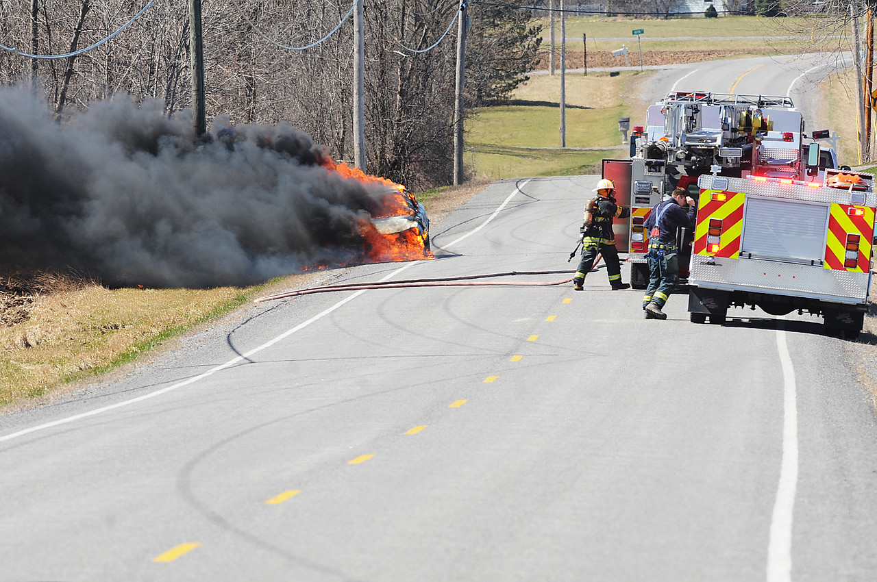 Jack Haley/Messenger Post Media<br /> Canandaigua firefighters were disptached to a working car fire on Yerkes Road Tuesday afternoon. Upon arrival they discovered the car fully engulfed. Smoke could be seen for miles until they extinquished it.