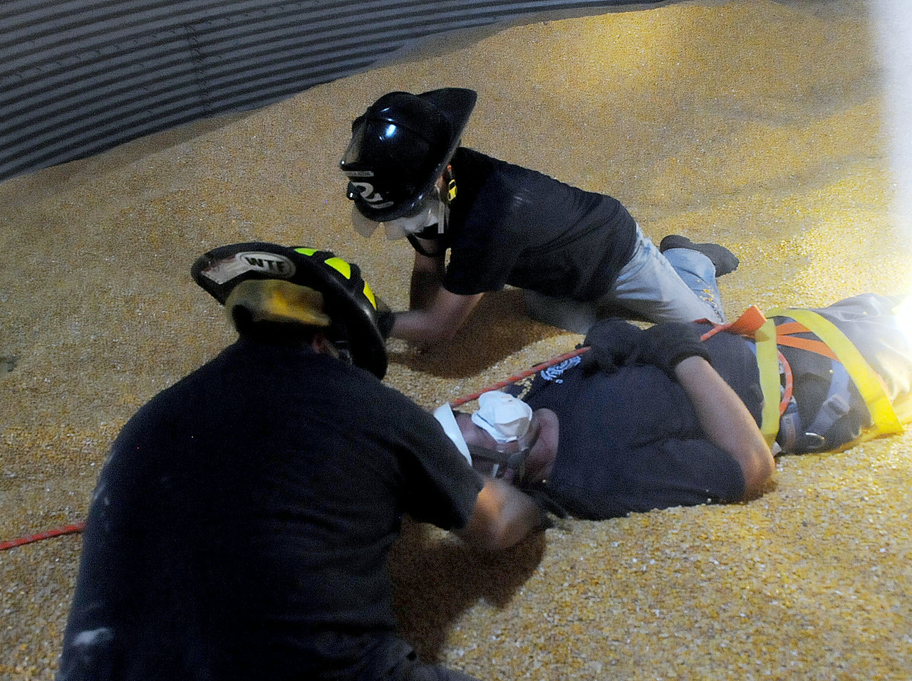Jack Haley/Messenger Post Media<br /> Canandaigua firefighters Jay Boock and Pat Phillips used a backboard to practice bringing a victim out of a bin containing corn. It is nearly impossible to stand in the bin partially filled with corn.