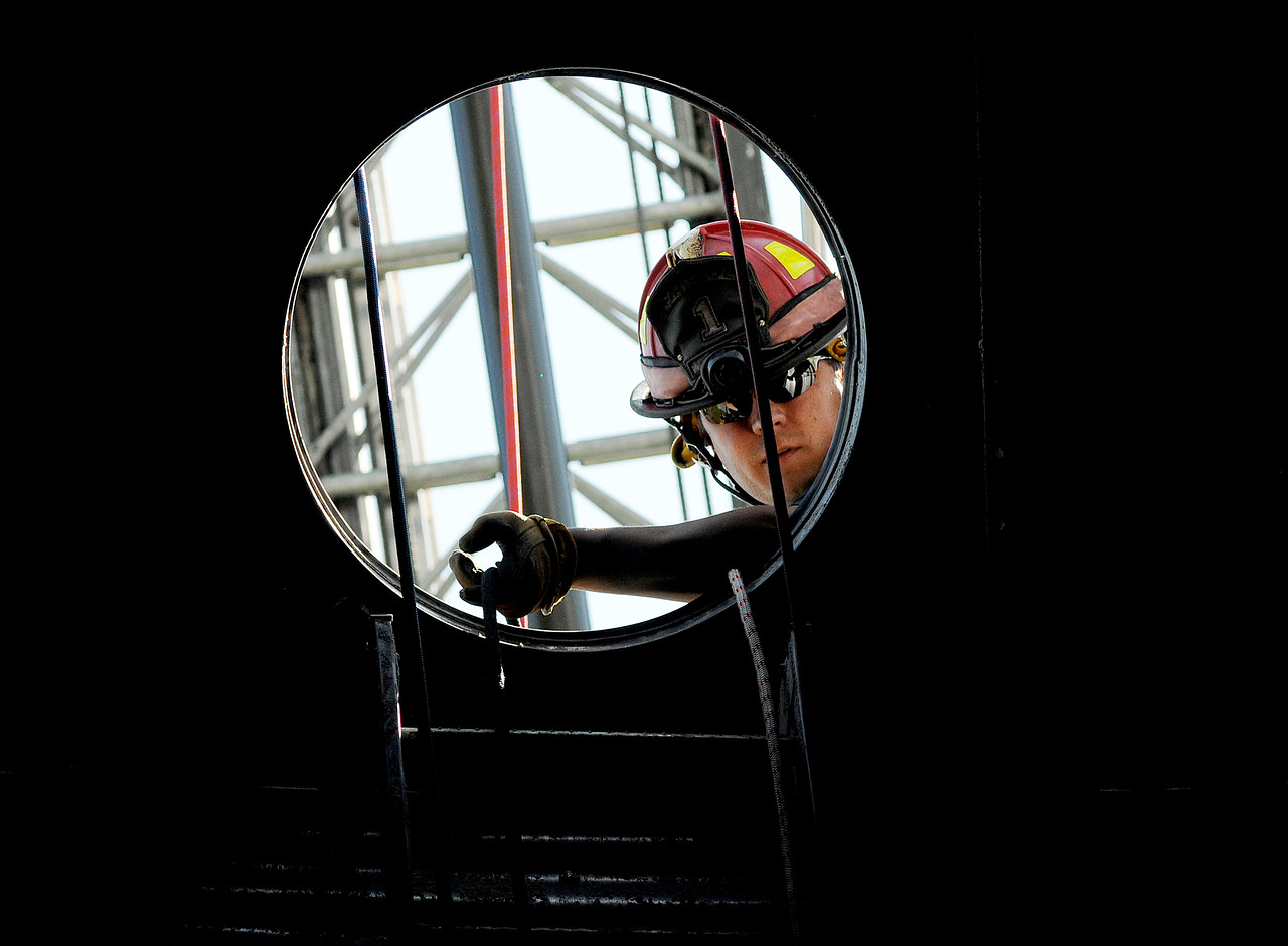 Jack Haley/Messenger Post Media<br /> A member of the Ontario County Rope Team lowers a line down into a grain bin during a drill hosted by the Canandaigua Fire Department with volunteers from all over Ontario County attending.