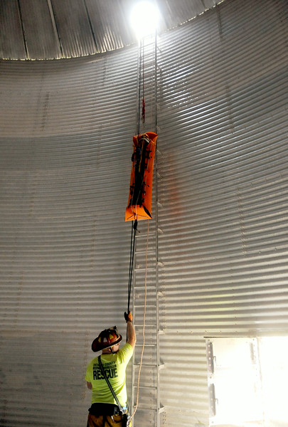 Jack Haley/Messenger Post Media<br /> A sked stretcher is used to bring a victim out of the grain bin by members of the Ontario County Rope Team.