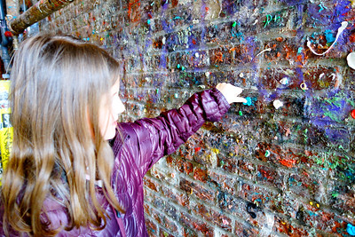 Carly making an addition to the gum wall