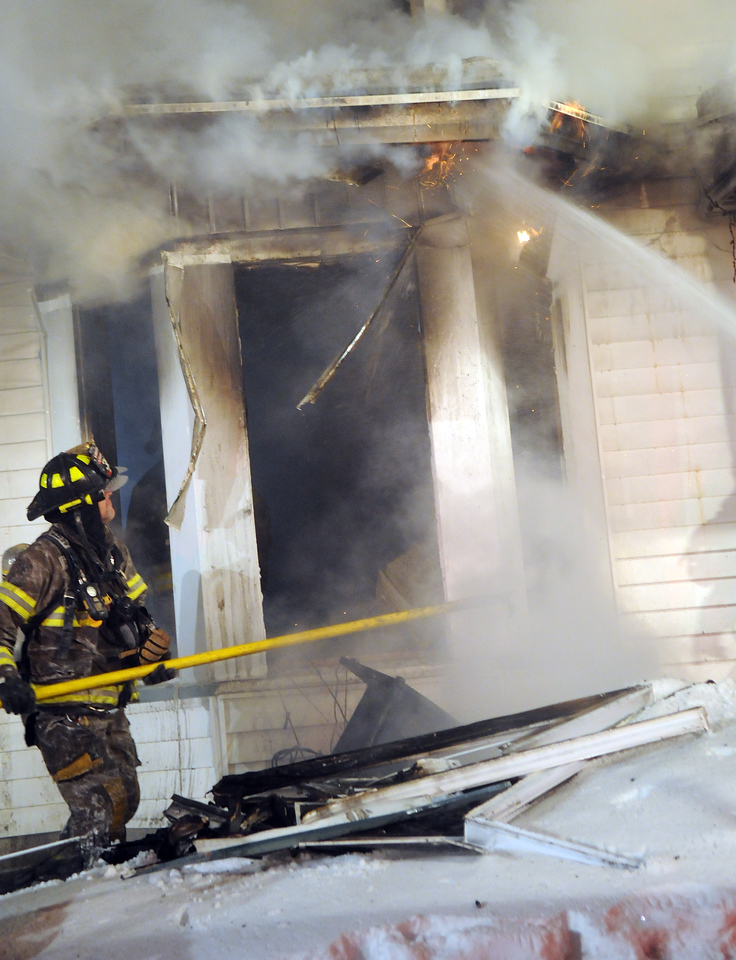 Nine Fire Departments battle a house fire on Commercial Street in Livonia on Valentines Day.
