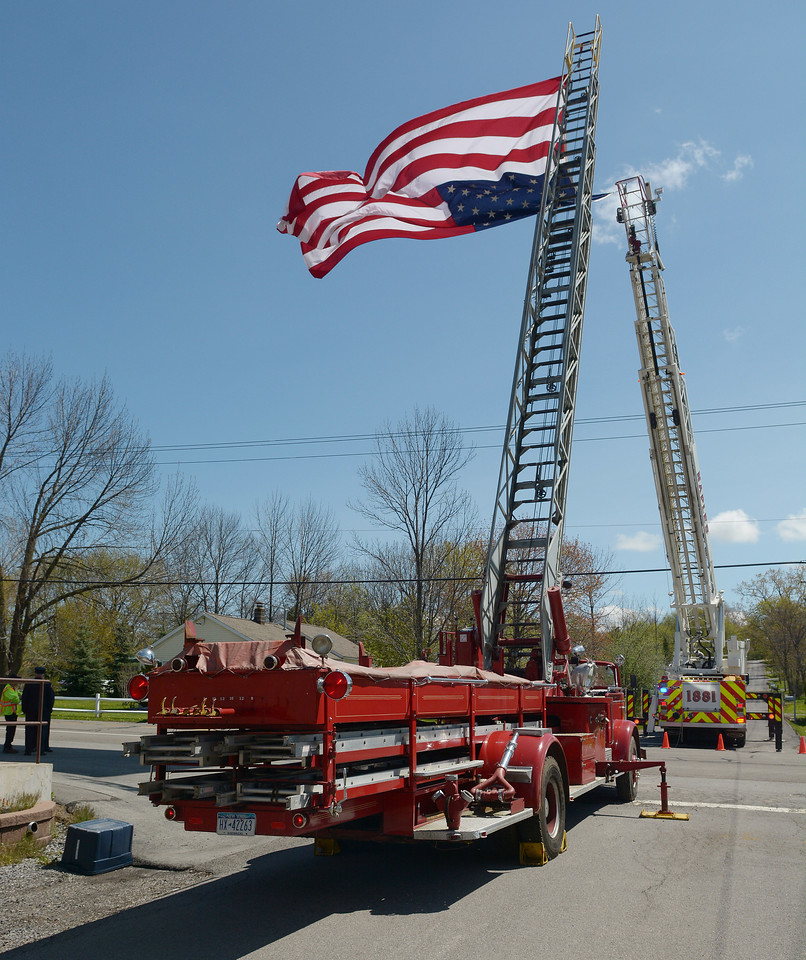 Firefighters honor Donald F. Barnes in front of the Crystal Beach Fire Department.