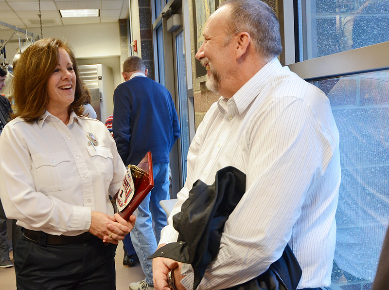 Lt. Sally Tata chats with retired firefighter Brian Aho during a retirement party for her at the Fitchburg Fire Department on Friday afternoon. Tata was the first woman to ever join the FFD. SENTINEL & ENTERPRISE / Ashley Green