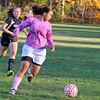 Keeping her eye on the ball is Fitchburg's Lauren Fowler. SENTINEL & ENTERPRISE/JOHN LOVE