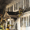 Jack Haley/Messenger Post Media<br /> Firefighters use pike poles to break second floor windows to help ventilate to remove smoke and heat.