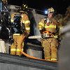 Jack Haley/Messenger Post Media<br /> Firefighters get ready to ventilate the roof on the second floor and hit hot spots.