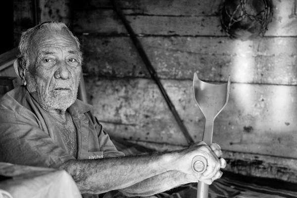 Playas del Coco, older man with paralysis anticipating death