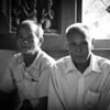 Laos, two gentlemen in temple