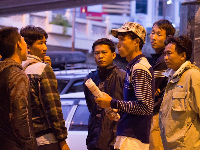 Myanmar, gentlemen hanging out at railroad station