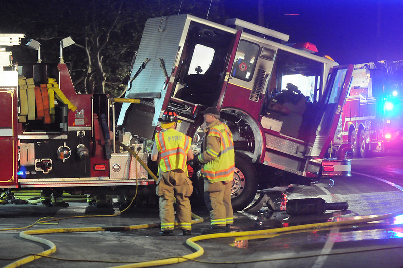Jack Haley/Messenger Post Media<br /> Possible electrical problems caused this fire truck to catch on fire inside the victor Fire Hall early Monday morning. East Bloomfield, Farmington and Fishers responded to the scene to assist.