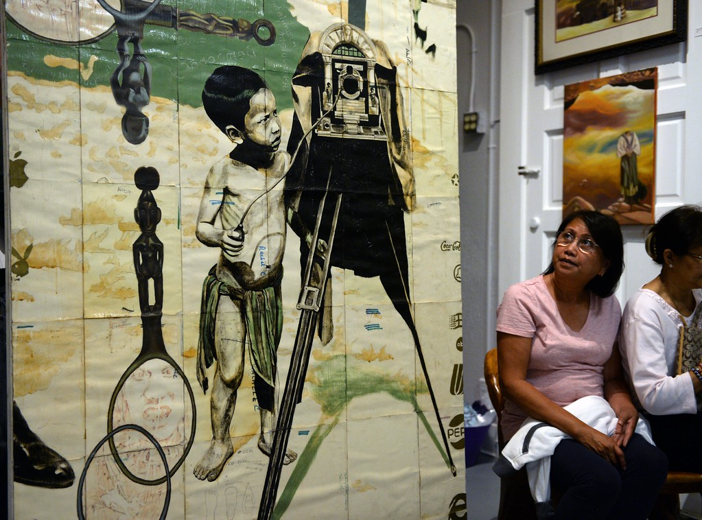 . San Pedro resident Lorna Long next to a piece by Eliseo Art Silva, at the Pinta Dos Philippine Art Gallery along 6th Street, during First Thursday Art Walk. San Pedro, Thursday, July 6, 2017.            ( Photo by Stephen Carr /  Daily Breeze / SCNG )