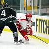 Fitchburg's #9 Ben Tolman tries to keep the puck away from Grafton's Nathaniel Metuzas during action in their game on Monday afternoon. SENTINEL & ENTERPRISE/JOHN LOVE