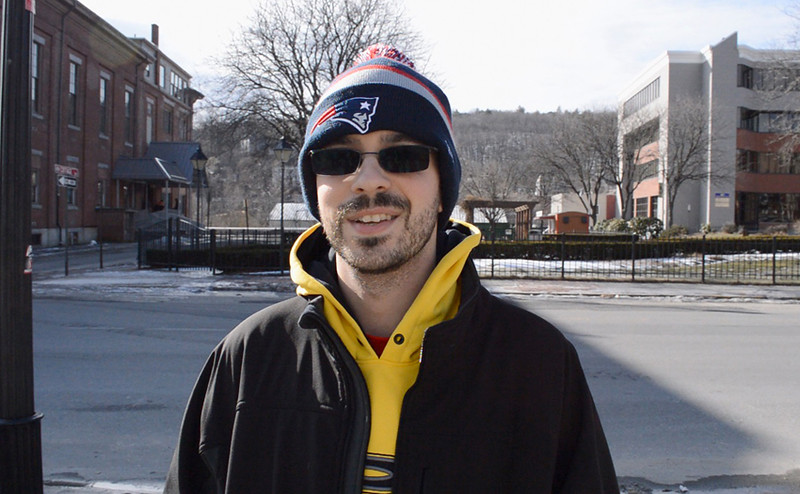 "When asked if the ""Deflate-Gate"" changed his mind about the Patriots, Anthony Palermo, a retail employee from Fitchburg answered, ""No, I'm still a die-hard Patriots fan--in Bill we trust."" Palermo is excited for the Superbowl and will be rooting for the Patriots. SENTINEL & ENTERPRISE/ ASHLEY LUCENTE"