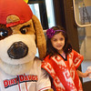 Ixchel Thibault-Munoz, 6, poses with Dirt Dawgs mascot Digger at the Many Flavors of Fitchburg event at Hammond Hall at Fitchburg State University on Thursday evening. SENTINEL & ENTERPRISE / Ashley Green