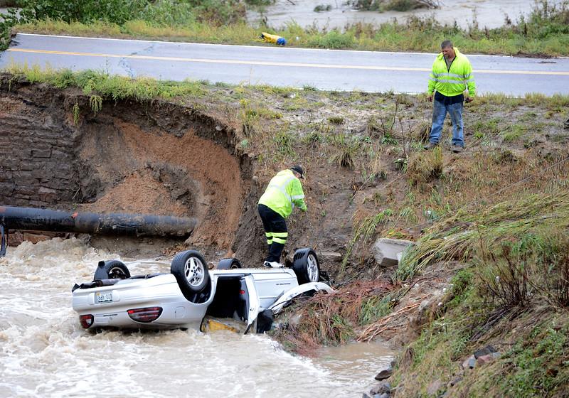 Bridge Out Car in Creek from Rain49  Bridge Out Car in Creek fro