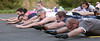 "Bob Raines-- Montgomery Media<br /> Fort Washington firefighters strain to hold their arms and legs off the ground in  one of their ""boot camp"" physical training session."