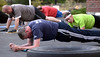 "Bob Raines-- Montgomery Media<br /> Firefighters work on back strengthening exercises at a Fort Washington Fire Co.""boot camp"" physical training session."